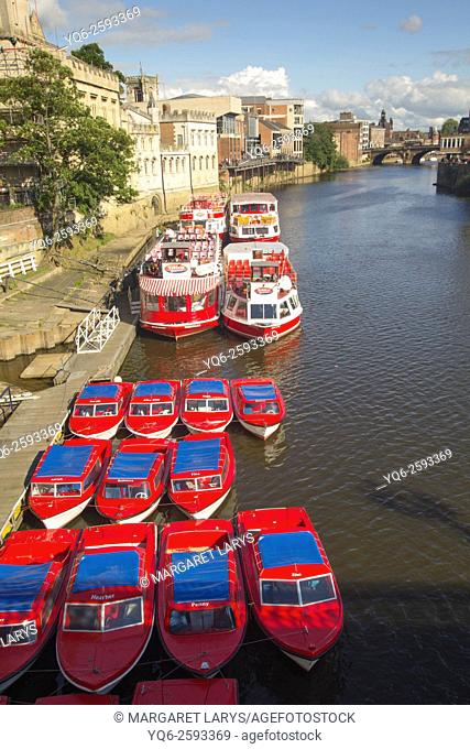 Passenger ferries alongside the quay on the River Ouse in York, England, United Kingdom