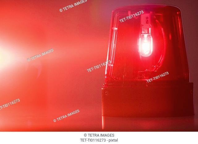 A glowing red emergency light