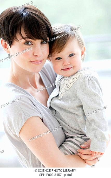 Mother and daughter. Mother holding her 15 month old daughter