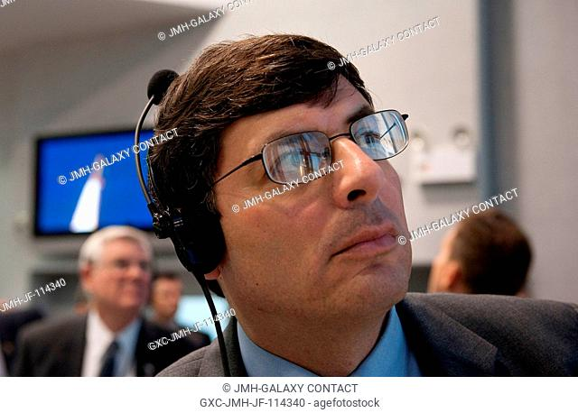 NASA Associate Administrator Chris Scolese monitors the launch of the Space Shuttle Atlantis from Firing Room 4 of NASA's Kennedy Space Center on Nov
