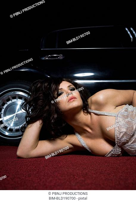 Glamorous Ukrainian woman posing next to car