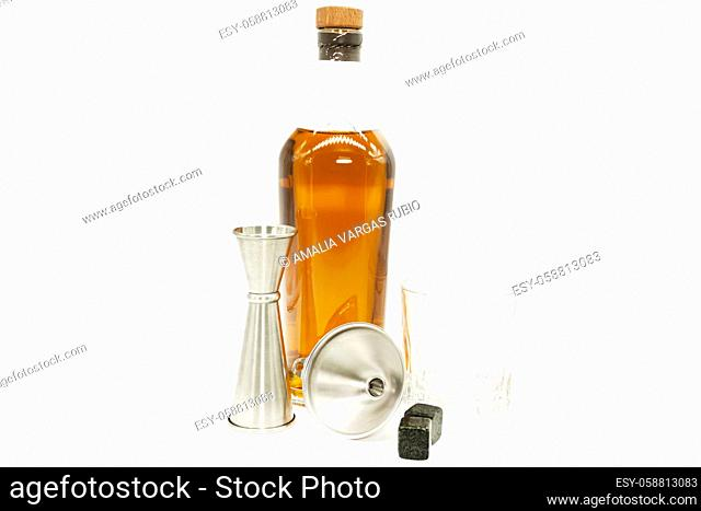 measure cup and funnel old fashon glass and stones for server Whiskey tools ready to drink