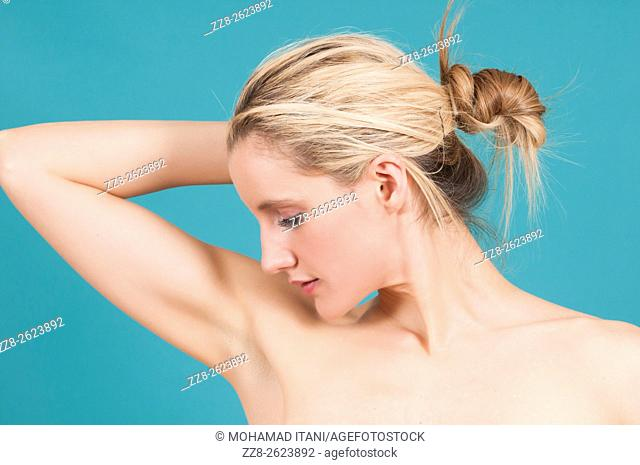 Woman looking at clean underarms