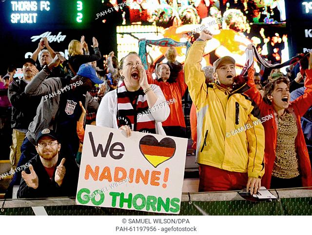 Fans cheer for Portland Thorns' goalkeeper Nadine Angerer warms up beofre her last home match of the season of the Portland Thorns against the Washington Spirit...