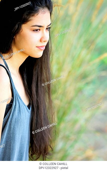 Portrait of a teenage girl with long, brown hair; Portland, Oregon, United States of America