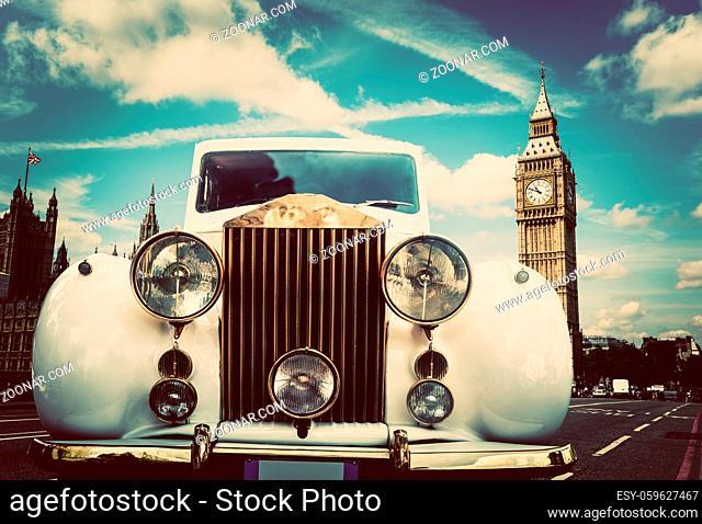 Retro car, limousine next to Big Ben, London, the UK. Concept travel elegant composition
