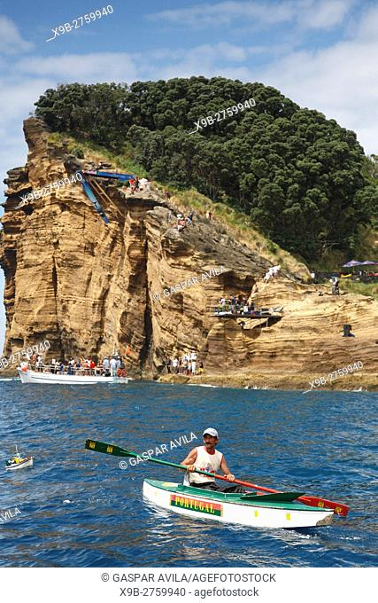 Man kayaking off the coast of Sao Miguel island, Azores islands, Portugal, during Red Bull Cliff Diving 2012