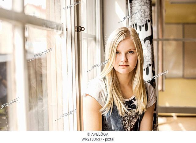 Portrait of girl by school window