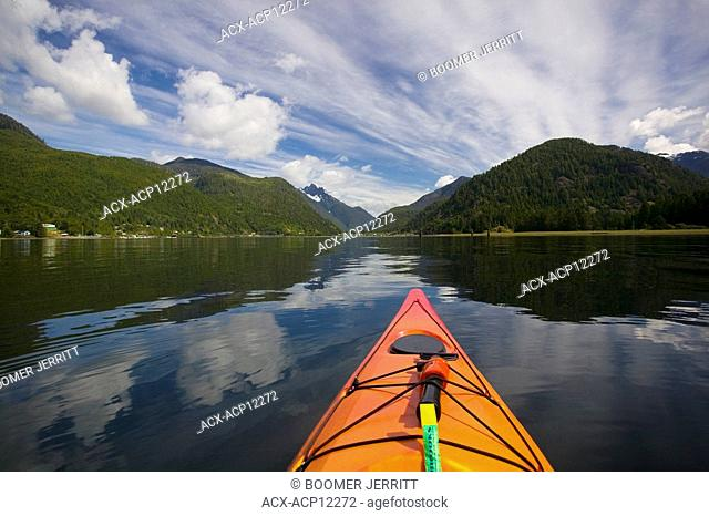 Kayaking in Tahsis inlet, coming into Tahsis, Rugged Mountain in background. Tahsis, Vancouver Island, British Columbia, Canada