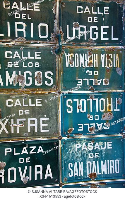 Collection of street signs in a door in Porrera, Priorat, Tarragona, Spain, Europe