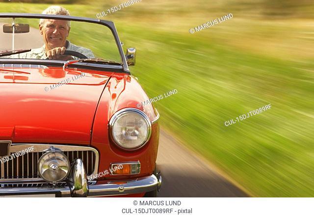 Senior man in sports car