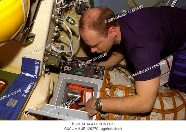 Cosmonaut Oleg V. Kotov, Expedition 15 flight engineer representing Russia's Federal Space Agency, works with a Cryogem-03 refrigerator in the Zvezda Service...