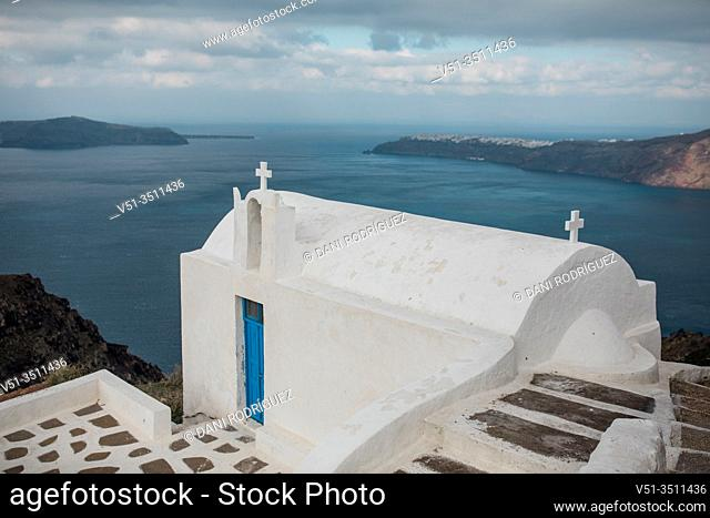 Views from Imerovigli, with a church, the Aegean Sea and Oia in Santorini, Greece