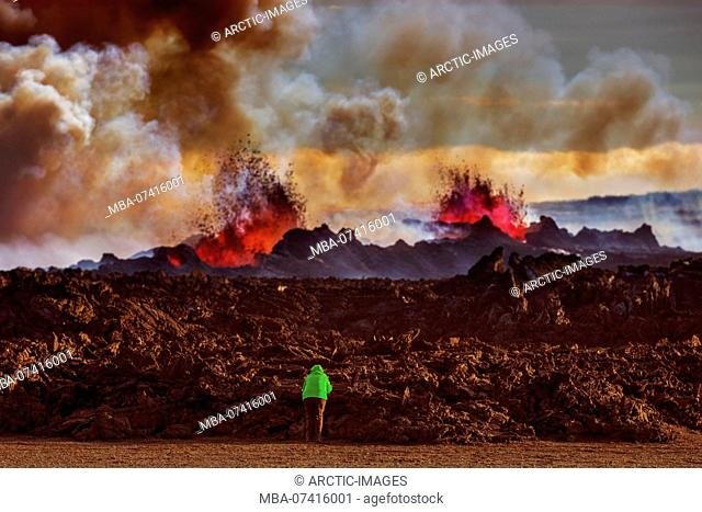 Person close to the new lava. August 29, 2014 a fissure eruption started in Holuhraun at the northern end of a magma intrusion