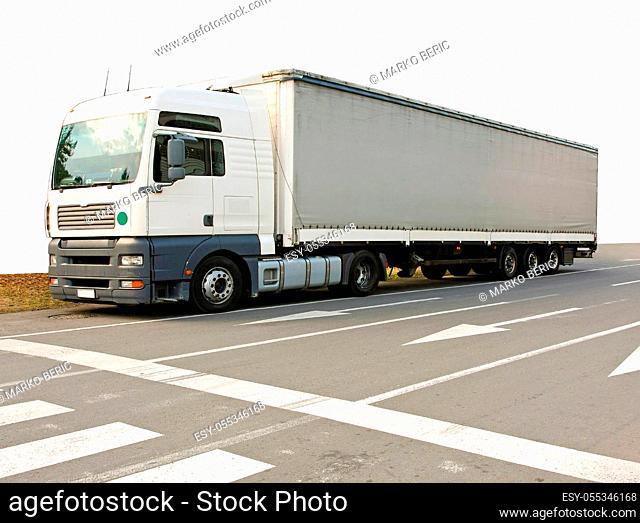 Big and long semi truck at street