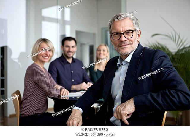 Business people having team meeting in office