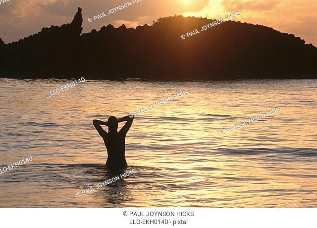 Silhouette of a Woman in the Ocean at Dawn  Mombasa, Kenya
