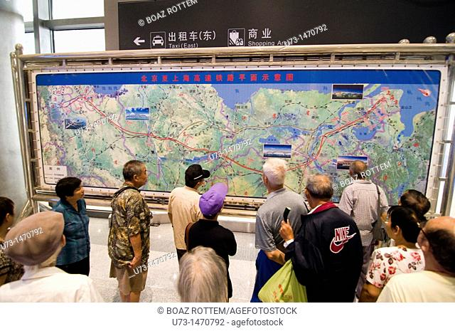 Passengers, in Nanjing south railway station, checking the new route of the CRH bullet train from Shanghai to Beijing ( via Nanjing )