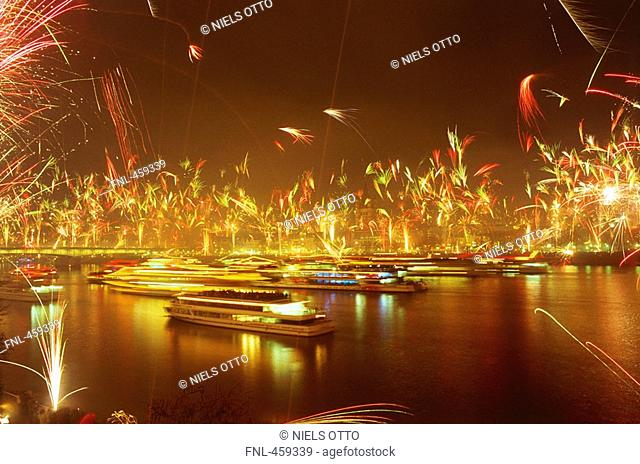 Boats at harbor with fireworks in background, Cologne, Germany
