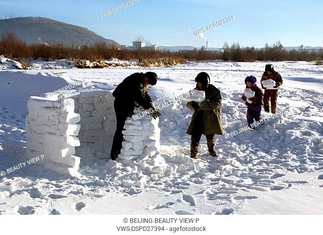 Children making a snowhouse in Heilongjiang province,China