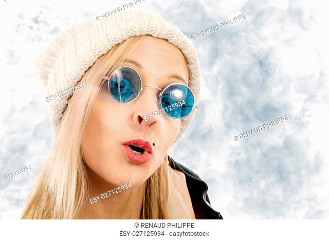 Portrait of a beautiful blond middle-aged woman with sunglasses