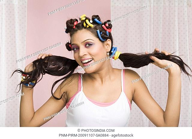 Woman holding her hair and smiling