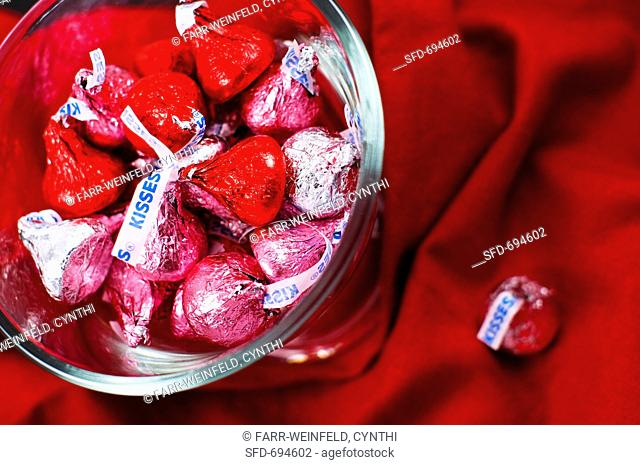 Red, Pink and Silver Chocolate Kisses in a Glass Dish, From Above