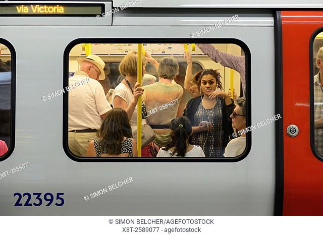 Crowded Tube Train Carriage on the London Underground, London, UK
