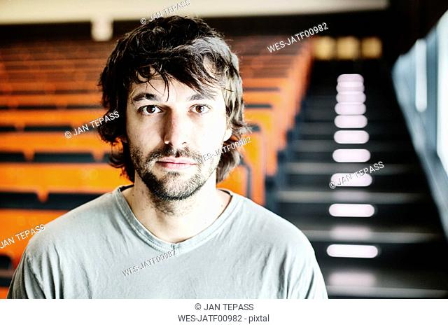 Portrait of student in auditorium at university