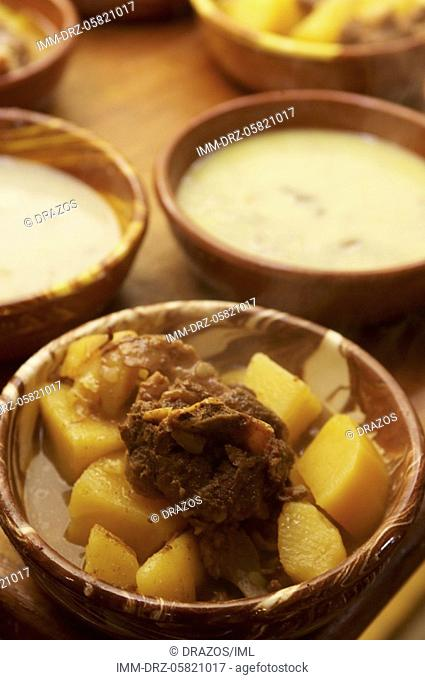 Local food, patatato meat with potatoes and Ksydato soup Amorgos, Cyclades, Greece