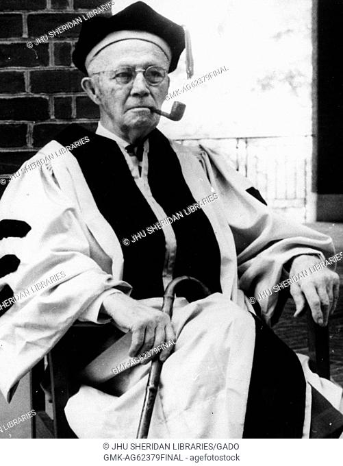 William Bennett Kouwenhoven, Candid photograph, Sitting, Smoking pipe, Preparing to receive honorary degree, c 80 years of age, 1965