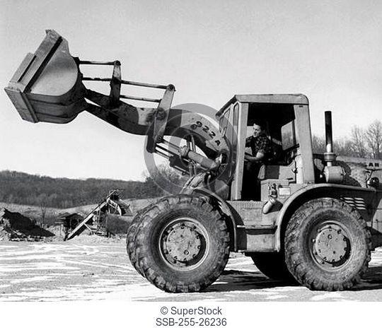 Man operating an excavator