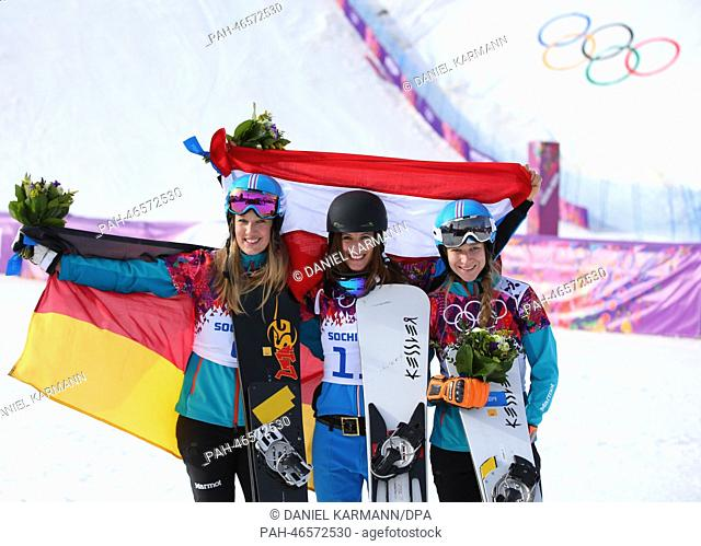 Second placed Anke Karstens of Germany (L), gold medal winner Julia Dujmovits of Austria and third placed Amelie Kober (R) of Germany celebrates during the...