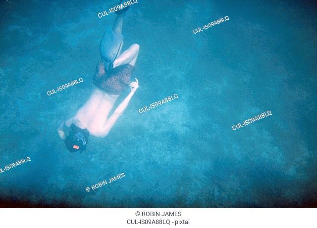 Man swimming in sea, high angle