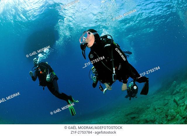 Three scuba divers in Mediterranean sea