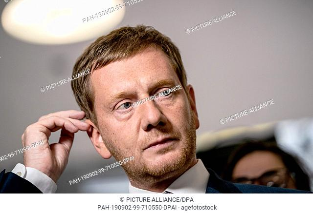 02 September 2019, Berlin: Michael Kretschmer, state chairman of the CDU and prime minister in Saxony, speaks before the press conference after the meeting of...