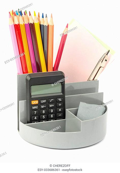 Pencil cup with calculator on isolated white background
