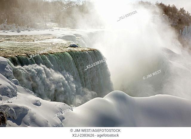 Niagara Falls, New York - Niagara Falls in winter. The American Falls is heavily coated in ice