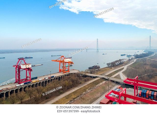 aerial view of inland container terminal with yangtze river in jiujiang, China