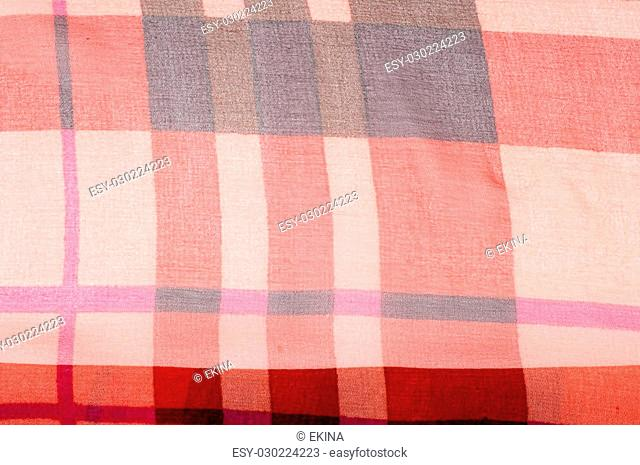 Silk fabric texture. red cell. Photography Studio