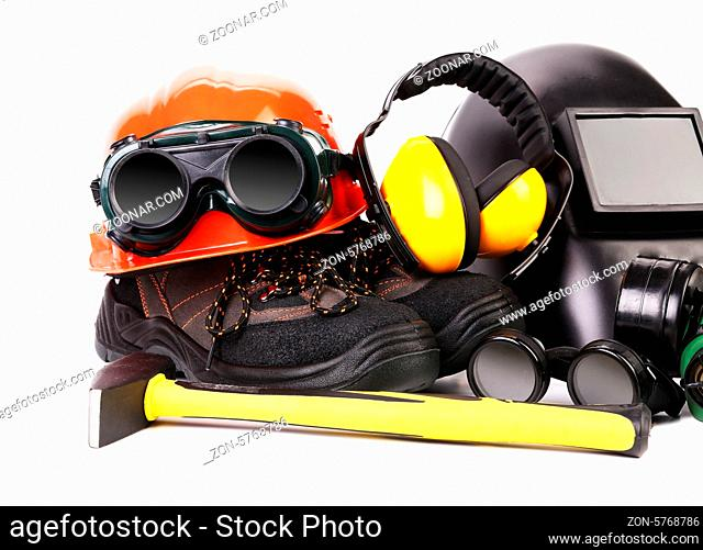 Hammer and protective gear for construction worker. Close up