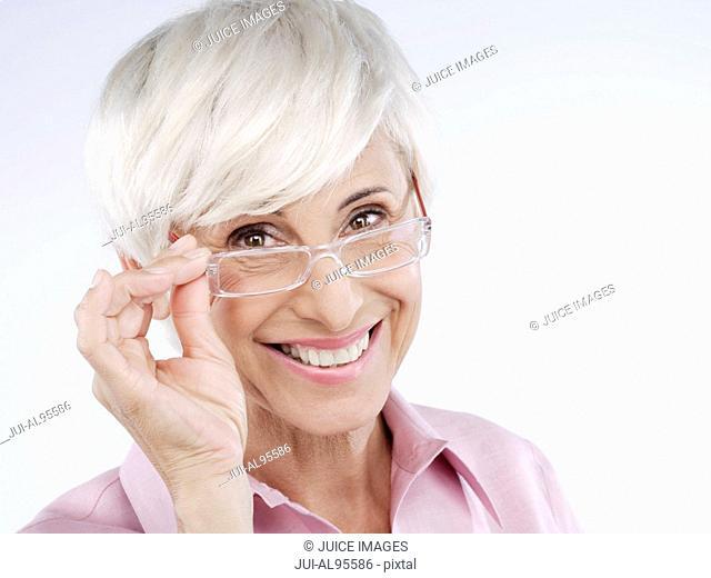 Senior woman wearing eyeglasses, portrait
