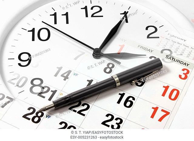 Pen on Calendar and Clock