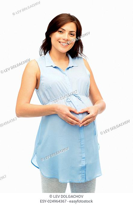 pregnancy, love, people and expectation concept - happy pregnant woman making heart gesture on belly over white background