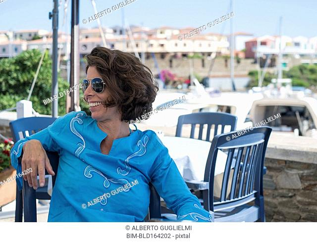 Caucasian woman sitting at outdoor cafe