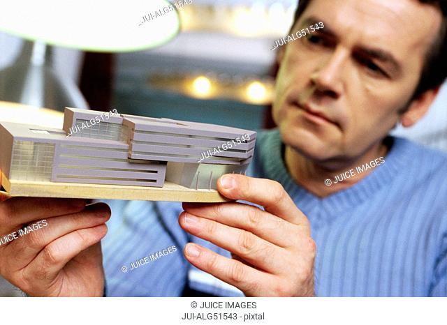 Man working on architect model