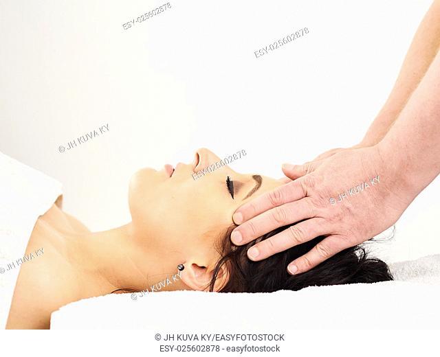 Massage, professional masseur and a woman customer