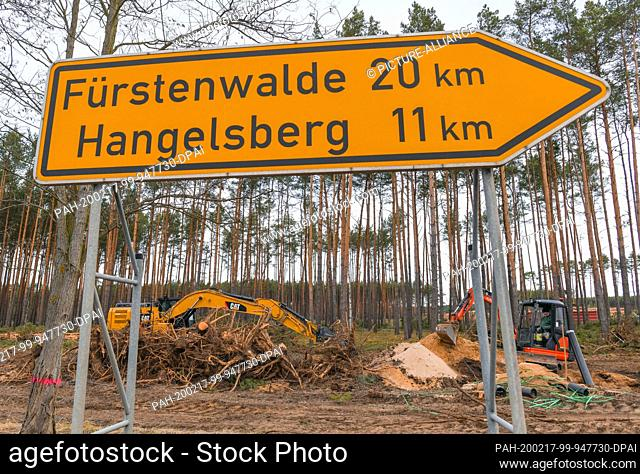 17 February 2020, Brandenburg, Grünheide: Construction machinery is located on the future Tesla Gigafactory site. Tesla is planning to build a gigafactory on...