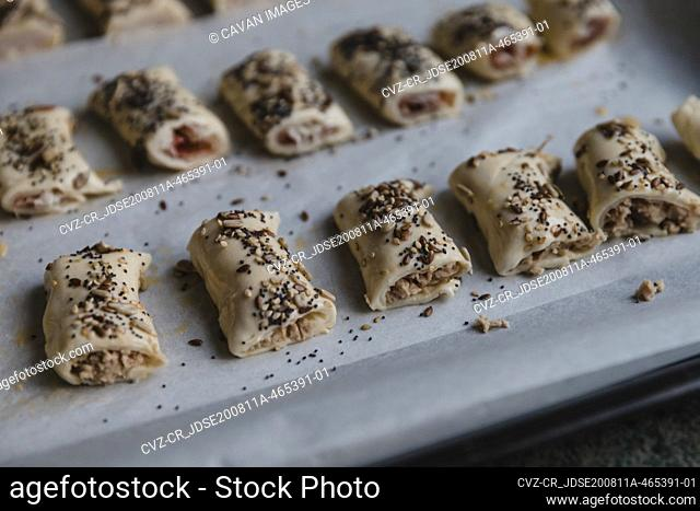 Meat rolls with sesame on tray