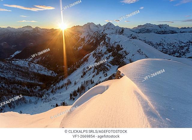 Europe, Italy, Veneto, Belluno. Snow ridges wave at sunset, Giau, Dolomites